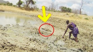 Locals Investigating Elephant Herd's Watering Hole Uncover The Weirdest Creature Living There