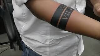 Band Tattoo With Name And Date In Roman Numerals