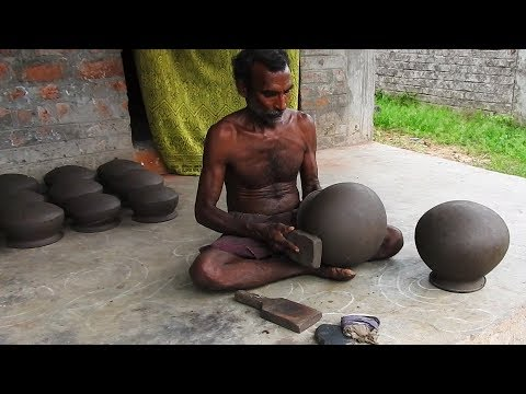 Pot maker in India using manual wheel