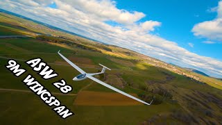 ASW 28 with 9m wingspan - chased by a fpv drone