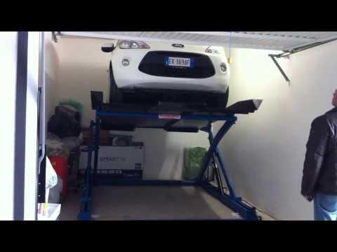 Sollevatore auto Ragno sollevamento a forbice con piano inclinabile per garage bassi.