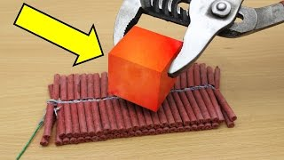 EXPERIMENT Glowing 1000 degree METAL CUBE vs 100 FIRECRACKERS