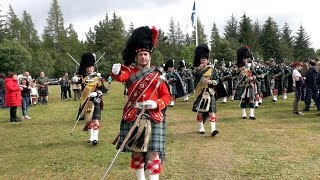 Chieftain leads the Pipe Bands at the close of 2019 Tomintoul Highland Games in Moray, Scotland
