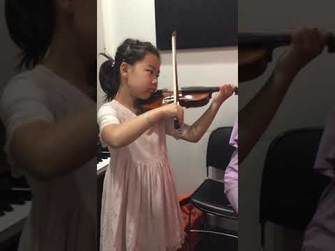 7 year old violin student displaying solid tone, beautiful technique, and good rhythm. Progress after only a year of studies.