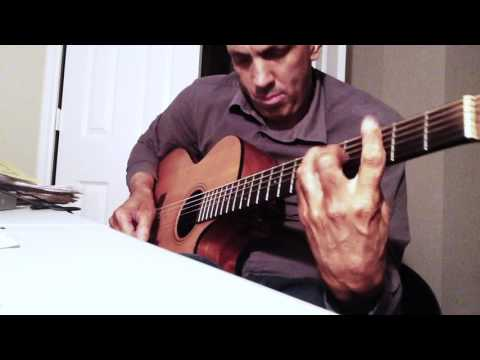 """Demonstration pick and finger style, or """"Hybrid Picking. Playing a solo version of Wayne Shorter's beautiful composition """"Ana Maria"""