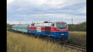 Тепловоз ТЭ33А-0182 с пассажирским поездом № 039Т Челябинск — Астана
