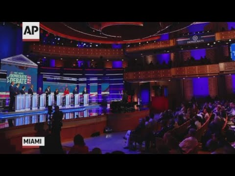 On a debate stage in Miami where a surprising amount of Spanish was spoken, Democrats blistered the White House for the deaths of a migrant father and his daughter whose drowned bodies were seen in searing photographs. (June 27)