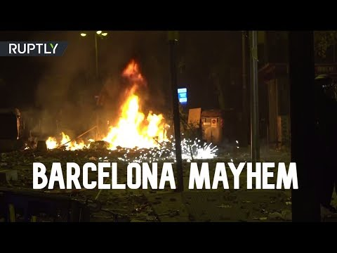 Clashes with police as 'half a million' protesters rally amid general strike in Barcelona