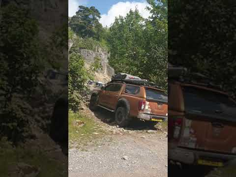 Mazda pickup and toyota hilux offroading
