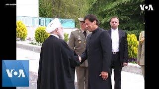Iran President welcomes Pakistan PM Khan with honor guard