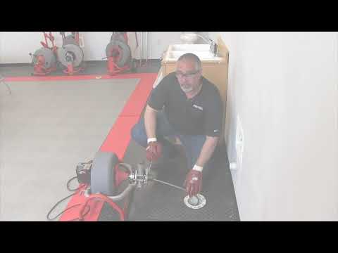 Using the RIDGID K3800 drum machine to clean a floor drain