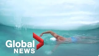 Swimmer plunges through Antarctica's waters for climate change awareness