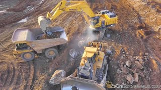Komatsu PC1250 Excavators loading 777F Haul Trucks on rocky residential project