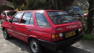 Part 2 . The Skoda Favorit Estate gets a waxing and the external trim gets a face lift .