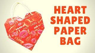Сумка валентинка на 14 февраля! Сделай подарок своими руками! В этом видео я покажу как сделать сумку-валентинку своими руками! Сделать это совсем не сложно, вам понадобится яркая упаковочная бумага, клей и две ленты. В такую сумку