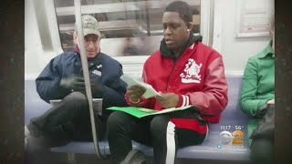 Photo Of Good Samaritan Straphanger Helping Man With Math Goes Viral