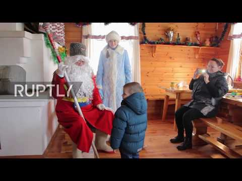 Watch a military-mad Santa from Belarus revel in Christmas festivities!