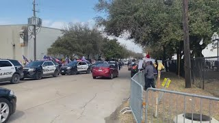 Protestors gather ahead of President Biden's arrival at Houston Food Bank   Raw video