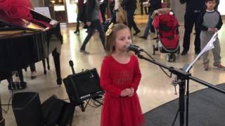 Ava singing Jolly Old St. Nicholas