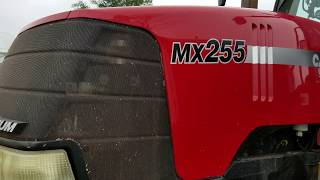How to operate the case MX 255 Magnum tractor getting ready to push corn silage