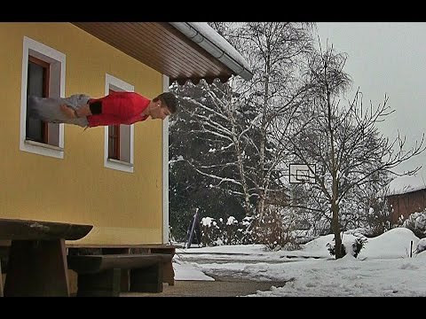 Crazy Acrobat Jumps Through Windows Like He's Trinity On The Matrix