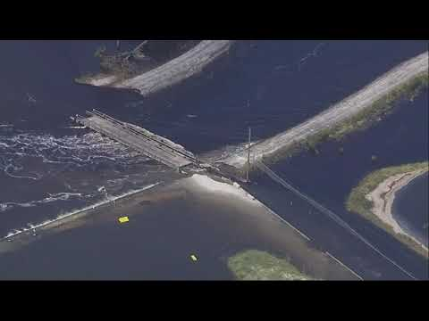 Duke Energy said Friday that a dam containing a large lake at a Wilmington power plant has been breached by floodwaters from Florence, and its possible coal ash from an adjacent dump is flowing into the Cape Fear River. (Sept. 21)
