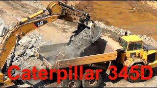 Caterpillar 345D Excavator Kaivinkone Load Volvo truck