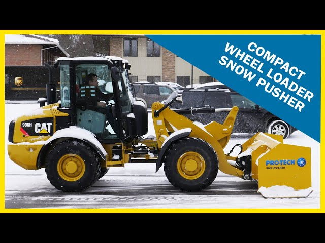 Compact Wheel Loader Sno Pusher in Action