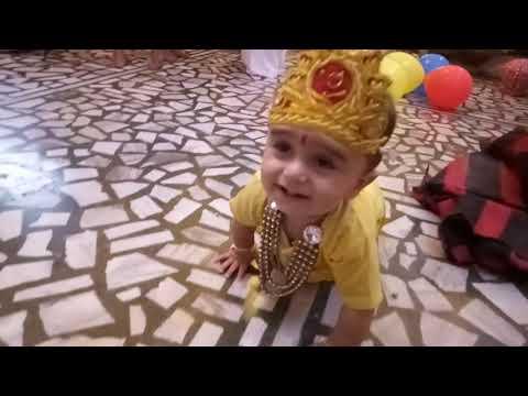 Little Krishna playing Happy Kirshan Janmasthmi