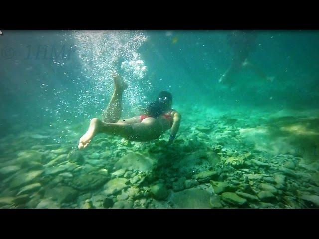 Pretty Girls Underwater swimming-  slow motion - Xcaret, Caribbean Sea - Maya Riviera