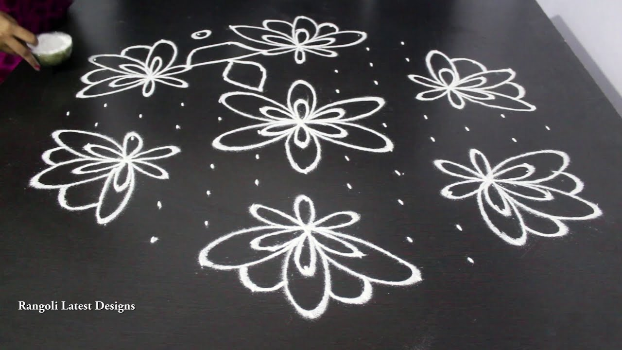 big dotted rangoli design by rangoli latest designs