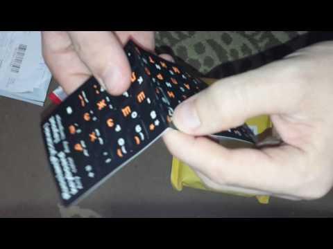 Зарядное устройство в прикуриватель, наклейка на клавиатуру, кулер охлаждения для ноутбука.