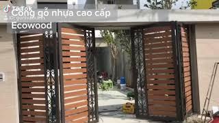 Thi công cổng gỗ nhựa ecowood , bản lề xoay tự động