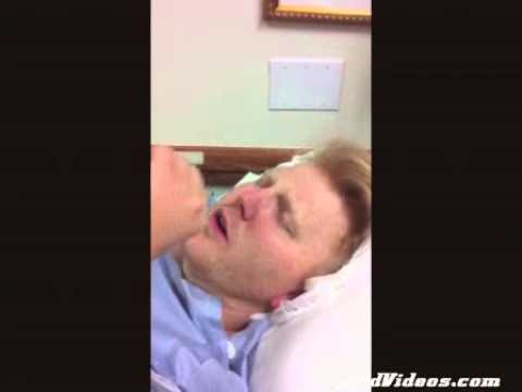Man coming out of surgery unknowingly starts flirting with his wife.