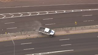 Truck flips during police chase
