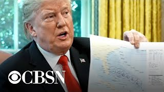 Trump weighs in on Hurricane Dorian and defends trade war with China
