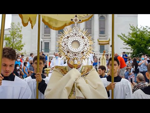 Bystanders Inspired by Eucharistic Procession