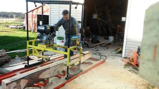 """Home made chainsaw mill cutting some 3/8"""" pine"""