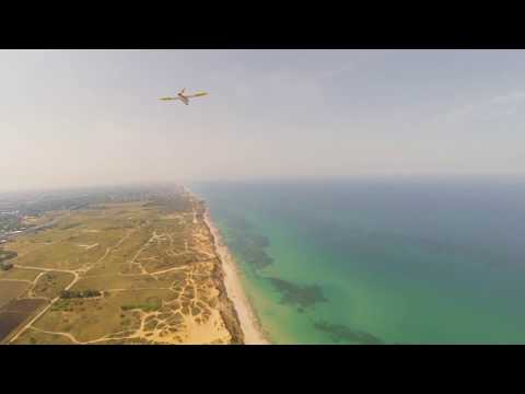 gimbaled-xuav-clouds-flying-in-formation-with-a-mini-talon