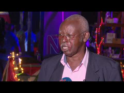 Union President Moses Matsiko calls out members to pick borrow aleaf from Kitante Club