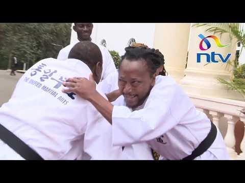 President Uhuru tries martial arts moves, gets a black belt