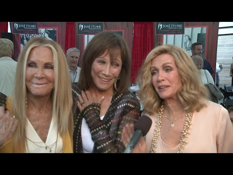 "Donna Mills, Michele Lee and Joan Van Ark - the leads of hit soap ""Knots Landing"" - discuss their friendship and whether they'd be open to an on-screen reunion. (July 19)"