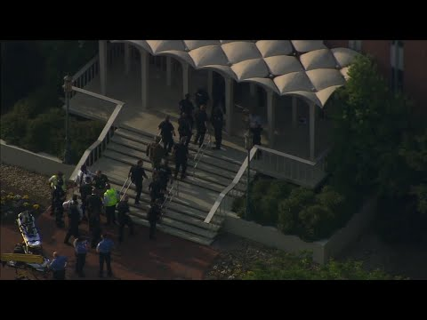 A shooting killed two people and wounded four at the University of North Carolina Charlotte campus on Tuesday. A suspect identified as 22-year-old Trystan Andrew Terrell is in custody. (May 1)