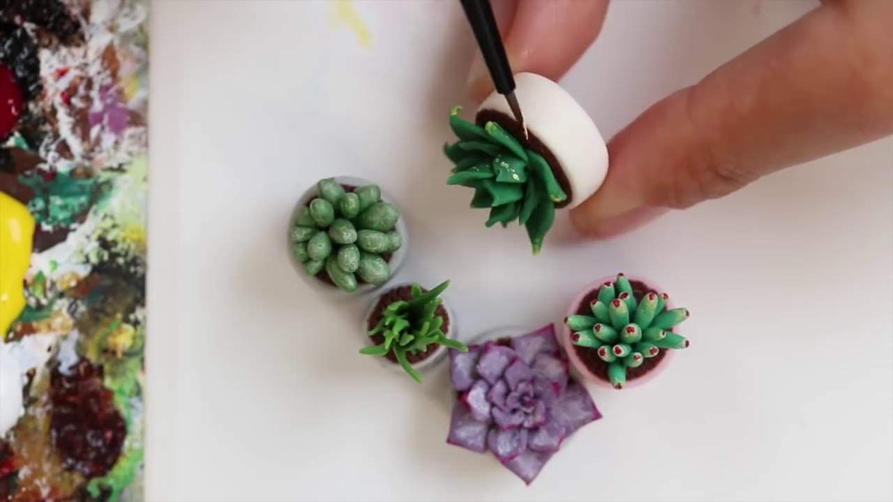 miniature sculptures of planters by stephanie kilgast