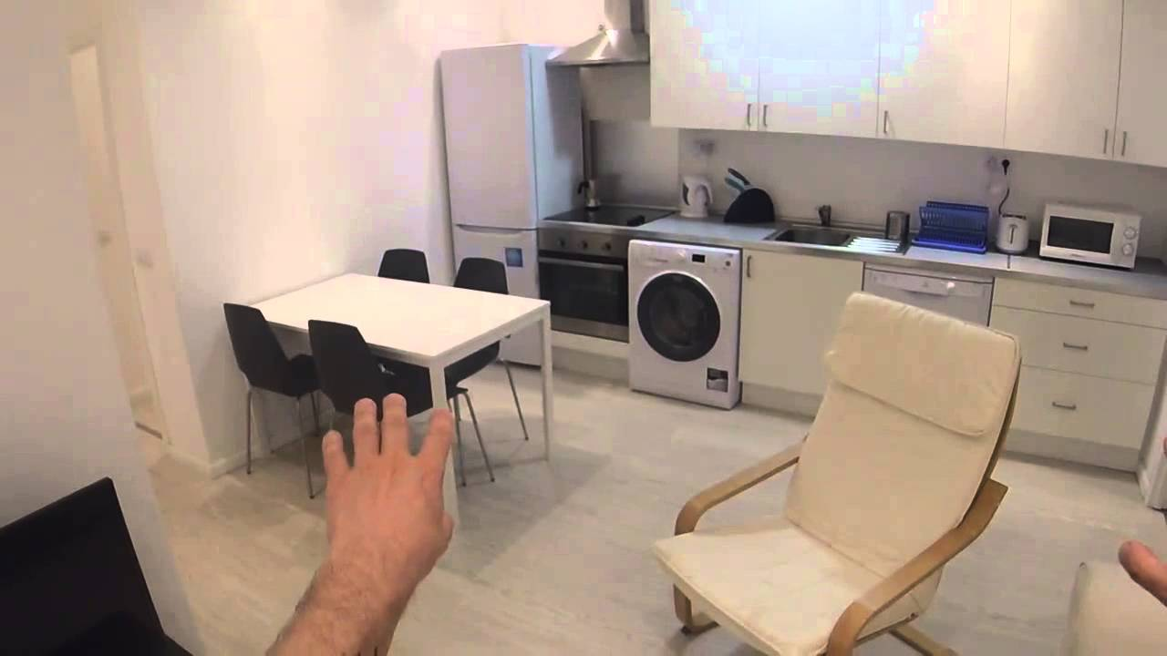 Inviting room with window with street view in shared apartment, Malasaña