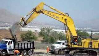Huge Komatsu PC1250 loading small Sterling dump truck