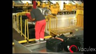 Loading Baggage from Chute to Open Cart - using Vaculex TP BaggageLift