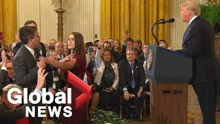 White House aide grabs mic from CNN