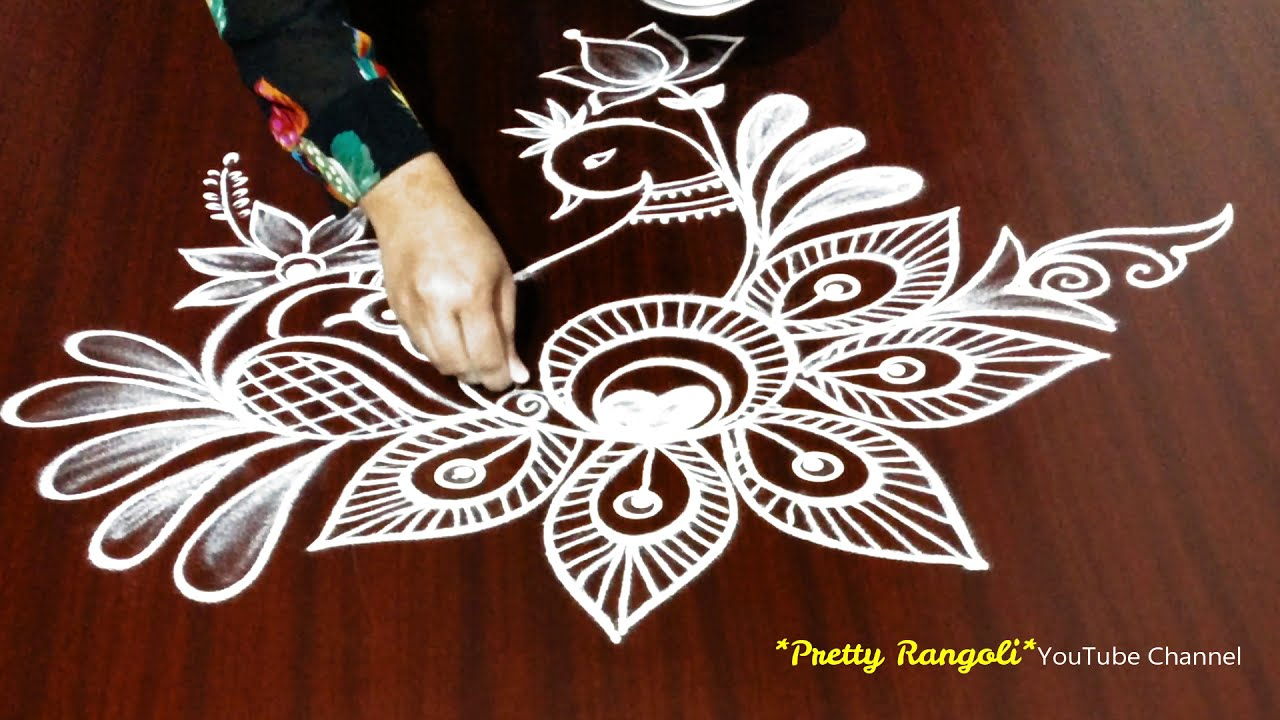 attractive peacock rangoli design by pretty rangoli