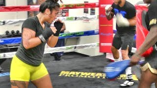Fe 'Epenisa, amateur boxer, padwork with Dewey Cooper inside the Mayweather Boxing Club